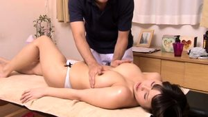 Busty Oriental cutie has a masseur plowing her aching cunt