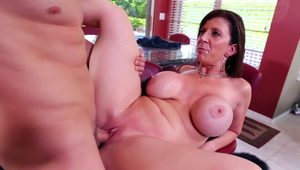 A big ass woman with huge tits is sucking a big cock in this scene